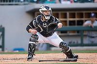 Charlotte Knights catcher Jeremy Dowdy (14) waits for a throw at home plate during the game against the Columbus Clippers at BB&T BallPark on May 27, 2015 in Charlotte, North Carolina.  The Clippers defeated the Knights 9-3.  (Brian Westerholt/Four Seam Images)