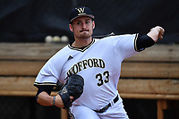 Starting pitcher Adam Scott (33) of the Wofford Terriers warms up before a game against the Furman Paladins on Friday, March 24, 2017, at Russell C. King Field in Spartanburg, South Carolina. Wofford won, 9-8. (Tom Priddy/Four Seam Images)