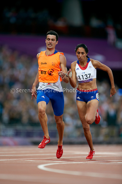 France's Assia El Hannouni and her guide, Gautier Simounet celebrate as she wins the women's T12 200m final in a word record time of 24:46 seconds at the London Paralympic Games - Athletics 6.9.12