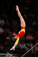 September 5, 2007; Stuttgart, Germany;  He Ning of China performs re-catch on uneven bars during team finals in women's artistic gymnastics at 2007 World Championships. Photo by Copyright 2007 Tom Theobald