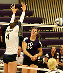 SIOUX FALLS, SD - SEPTEMBER 19:  Michelle Ritland #12 from the University of Sioux Falls slips the ball past Becca Finley #4 from Augustana during their match Saturday afternoon at the Stewart Center. (Photo by Dave Eggen/Inertia)