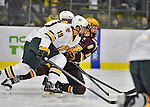 24 November 2012: University of Minnesota Golden Gopher forward Erik Haula, a Junior from Pori, Finland, is checked by University of Vermont Catamount forward Matt White, a Junior from McMurray, PA, during the first period of play at Gutterson Fieldhouse in Burlington, Vermont. The Gophers defeated the Catamounts 3-1 in the second game of their 2-game non-divisional weekend series. Mandatory Credit: Ed Wolfstein Photo