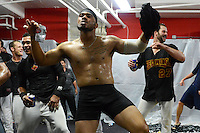 Rochester Red Wings infielder Eric Farris (no shirt) leads the dance as the team, including Ray Olmedo and Aaron Thompson, join in during a celebration in the locker room after defeating the Scranton Wilkes Barre RailRiders on September 2, 2013 at Frontier Field in Rochester, New York to clinch the International League Wild Card Playoff spot.  (Mike Janes/Four Seam Images)
