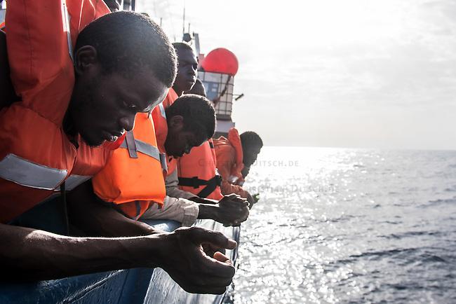 Sea Watch-2.<br /> Die Sea Watch-2 bei ihrer 13. SAR-Mission vor der libyschen Kueste.<br /> Die Sea Watch-2 hat am 22. Oktober 2016 knapp 200 Menschen an Bord aufgenommen. Sie mussten bis zum naechsten Tag auf dem Deck ausharren, bis ein Frontex-Schiff der spanischen Marine kam um sie nach Italien zu bringen.<br /> 23.10.2016, Mediterranean Sea<br /> Copyright: Christian-Ditsch.de<br /> [Inhaltsveraendernde Manipulation des Fotos nur nach ausdruecklicher Genehmigung des Fotografen. Vereinbarungen ueber Abtretung von Persoenlichkeitsrechten/Model Release der abgebildeten Person/Personen liegen nicht vor. NO MODEL RELEASE! Nur fuer Redaktionelle Zwecke. Don't publish without copyright Christian-Ditsch.de, Veroeffentlichung nur mit Fotografennennung, sowie gegen Honorar, MwSt. und Beleg. Konto: I N G - D i B a, IBAN DE58500105175400192269, BIC INGDDEFFXXX, Kontakt: post@christian-ditsch.de<br /> Bei der Bearbeitung der Dateiinformationen darf die Urheberkennzeichnung in den EXIF- und  IPTC-Daten nicht entfernt werden, diese sind in digitalen Medien nach &sect;95c UrhG rechtlich geschuetzt. Der Urhebervermerk wird gemaess &sect;13 UrhG verlangt.]
