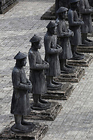 Tomb of Emperor Khai Dinh with small mandarin soldier statues, Hue, Viet Nam.
