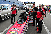 Mar. 9, 2012; Gainesville, FL, USA; NHRA crew members for top fuel dragster driver Chris Karamesines during qualifying for the Gatornationals at Auto Plus Raceway at Gainesville. Mandatory Credit: Mark J. Rebilas-
