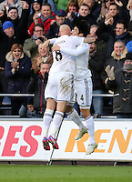 SWANSEA, WALES - FEBRUARY 21: Ki Sung Yueng of Swansea (R) celebrates his equaliser with Jonjo Shelvey during the Barclays Premier League match between Swansea City and Manchester United at Liberty Stadium on February 21, 2015 in Swansea, Wales.