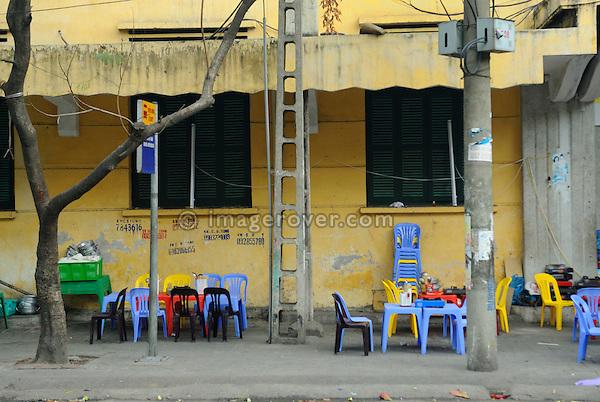 Asia, Vietnam, Hanoi. Hanoi old quarter. Colourful plastic chairs at a roadside restaurant.