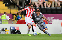 Lincoln City's Jack Payne vies for possession with Stoke City's Stephen Ward<br /> <br /> Photographer Chris Vaughan/CameraSport<br /> <br /> Football Pre-Season Friendly - Lincoln City v Stoke City - Wednesday July 24th 2019 - Sincil Bank - Lincoln<br /> <br /> World Copyright © 2019 CameraSport. All rights reserved. 43 Linden Ave. Countesthorpe. Leicester. England. LE8 5PG - Tel: +44 (0) 116 277 4147 - admin@camerasport.com - www.camerasport.com