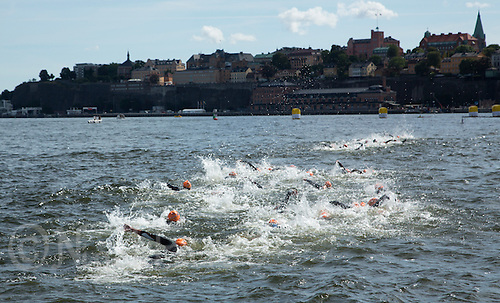 24 AUG 2013 - STOCKHOLM, SWE - Competitors start  their second swim lap during the elite women's ITU 2013 World Triathlon Series round in Gamla Stan in Stockholm, Sweden (PHOTO COPYRIGHT © 2013 NIGEL FARROW, ALL RIGHTS RESERVED)