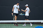 Christian Seraphim (left) and Ian Dempster of the Wake Forest Demon Deacons during their match at #3 doubles against the Texas A&M Aggies during the semifinals at the 2018 NCAA Men's Tennis Championship at the Wake Forest Tennis Center on May 21, 2018 in Winston-Salem, North Carolina. The Demon Deacons defeated the Aggies 4-3. (Brian Westerholt/Sports On Film)
