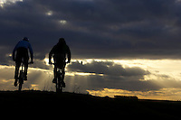 Nick Larsen and James Blackwell..Mountain bike silhouette , Salisbury Plain , near Edington , Wiltshire  February 2006..pic copyright Steve Behr / Stockfile