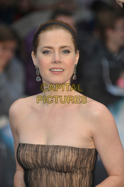 Amy Adams<br /> 'Man Of Steel' UK film premiere, Empire cinema, Leicester Square, London, England. <br /> 12th June 2013<br /> headshot portrait beige black strapless pattern alice band dangling earrings brown<br /> CAP/PL<br /> &copy;Phil Loftus/Capital Pictures
