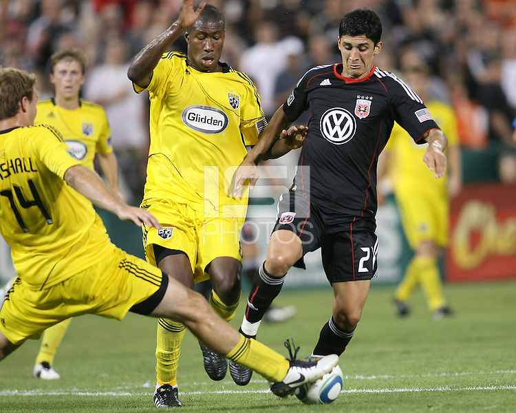 Pablo Hernandez #21 of D.C. United moves the ball away from Andy Iro #6 and Chad Marshall #14 of the Columbus Crew during a US Open Cup semi final match at RFK Stadium on September 1 2010, in Washington DC. Crew won 2-1.