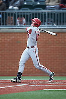 Heston Kjerstad (18) of the Arkansas Razorbacks follows through on his swing against the Charlotte 49ers at Hayes Stadium on March 21, 2018 in Charlotte, North Carolina.  The 49ers defeated the Razorbacks 6-3.  (Brian Westerholt/Four Seam Images)