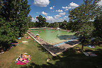 Deep Eddy Pool is a hidden gem for sun tanning and a cool dip in the pool afterwards.