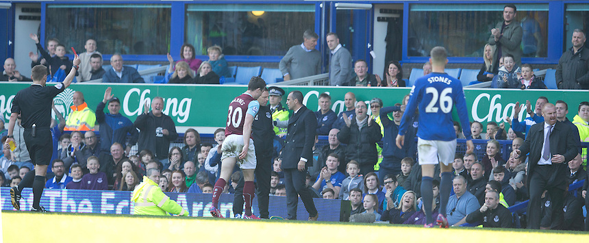 RED CARD, SENDING OFF - Burnley's Ashley Barnes heads for the dressing room after receiving a red card from Referee Mike Jones for a tackle on Everton's Seamus Coleman resulting in a second yellow card<br /> <br /> Photographer Stephen White/CameraSport<br /> <br /> Football - Barclays Premiership - Everton v Burnley - Saturday 18th April 2015 - Goodison Park - Everton<br /> <br /> &copy; CameraSport - 43 Linden Ave. Countesthorpe. Leicester. England. LE8 5PG - Tel: +44 (0) 116 277 4147 - admin@camerasport.com - www.camerasport.com