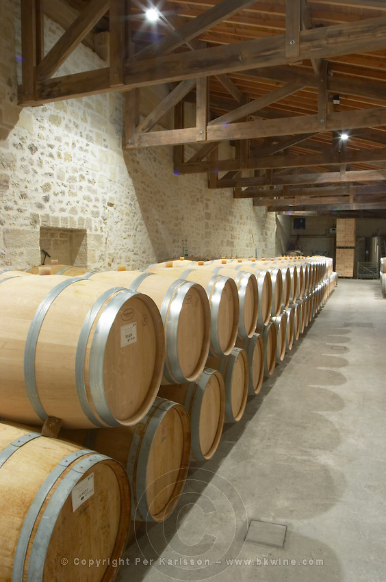 Oak barrel aging and fermentation cellar. Chateau Clos Fourtet, Saint Emilion, Bordeaux, France