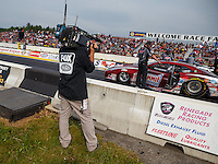 Jun 3, 2016; Epping , NH, USA; A Fox Sports television cameraman records NHRA pro stock driver Greg Anderson during qualifying for the New England Nationals at New England Dragway. Mandatory Credit: Mark J. Rebilas-USA TODAY Sports