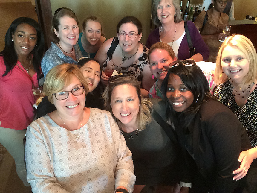 Selfie stick used at the 2015 Staff Appreciation Reception. (On right, Anne Shaughnessy, and next to her on left, Jamie Rizzo, of the President's Office; Claudia Borden, center, of Finance)