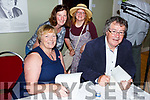 Gabriel Fitzmaurice signing his new book of poems 'Smitten Soul' in the Seanchai Centre on Thurday during Listowel Writers Week.    Seated l-r Gabriel and Brenda Fitzmaurice.<br /> Back l-r Katie Croxall and Mairead O'Leary.