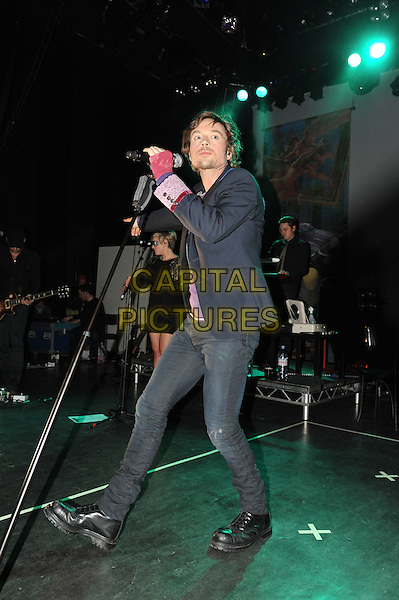 Darren Hayes.Live in concert at the Shepherd's Bush Empire, London, England. 19th October 2011.performing singing on stage performance gig music full length black jacket jeans denim pink bandage.CAP/MAR.© Martin Harris/Capital Pictures.