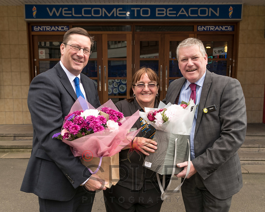 Brenda Ancliff retires from Beacon Bingo in Ilkeston after 30 years. Brenda is pictured receiving a bunch of flowers from Operatons Manager Phil Gibbs (left) and Manager Martin Riley