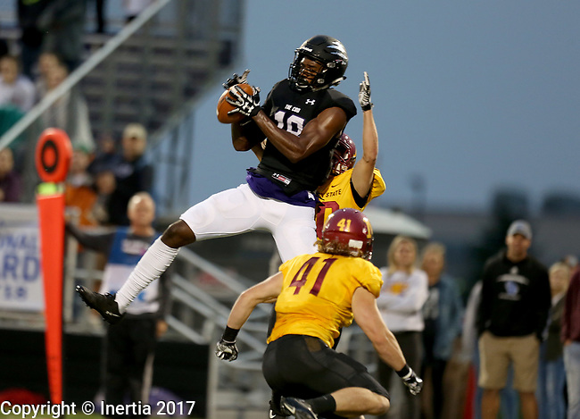SIOUX FALLS, SD - SEPTEMBER 8: Anthony Holmes #18 from the University of Sioux Falls hauls in a pass over a pair of defenders including Alex Gray #41 from Northern State in the first half of their game Saturday night at Bob Young Field in Sioux Falls. (Photo by Dave Eggen/Inertia)