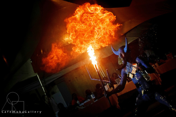 Traditional mas - Blue devil jab molaasie breathing fire with dollars stuck to his chest at night