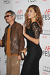 HOLLYWOOD, CA - NOVEMBER 03: Leos Carax and Eva Mendes arrives at the 2012 AFI FEST - 'Holy Motors' Gala Screening at Grauman's Chinese Theatre on November 3, 2012 in Hollywood, California.