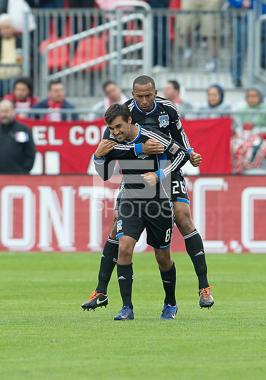 24 March 2012: San Jose Earthquakes defender Victor Bernardez #26 celebrates a goal by San Jose Earthquakes forward Chris Wondolowski #8 during a game between the San Jose Earthquakes and Toronto FC at BMO Field in Toronto..The San Jose Earthquakes won 3-0..