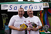 Couple of men displaying safe sex leaflets on the SafeGay stall at the Nottingham Pride Gay Lesbian festival; held at the Arboretum,