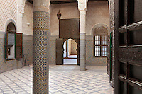Central hall with carved stucco decoration and zellige tiles, Kasbah of the Glaoua family, Telouet, High Atlas, Morocco. The fortress was begun in the 19th century as the residence Thami el Glaoui, 1879-1956, who was Pasha of Marrakech 1912-56. It sits at 1800m in the Atlas mountains on an ancient caravan route from the Sahara to Marrakech. Picture by Manuel Cohen