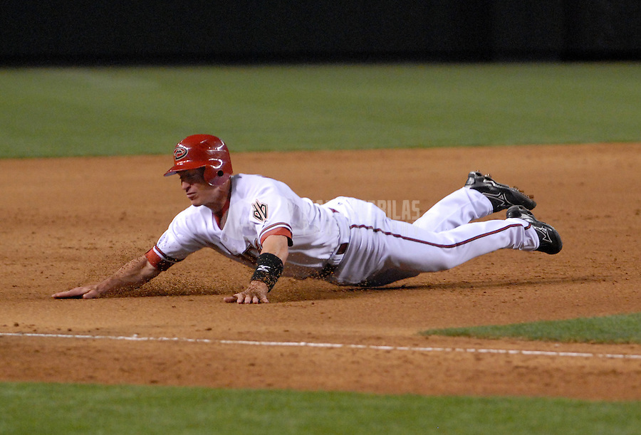 Apr 9, 2007; Phoenix, AZ, USA; Arizona Diamondbacks catcher (5) Robby Hammock dives into third base against the Cincinnati Reds during the home opener at Chase Field in Phoenix, AZ. Mandatory Credit: Mark J. Rebilas