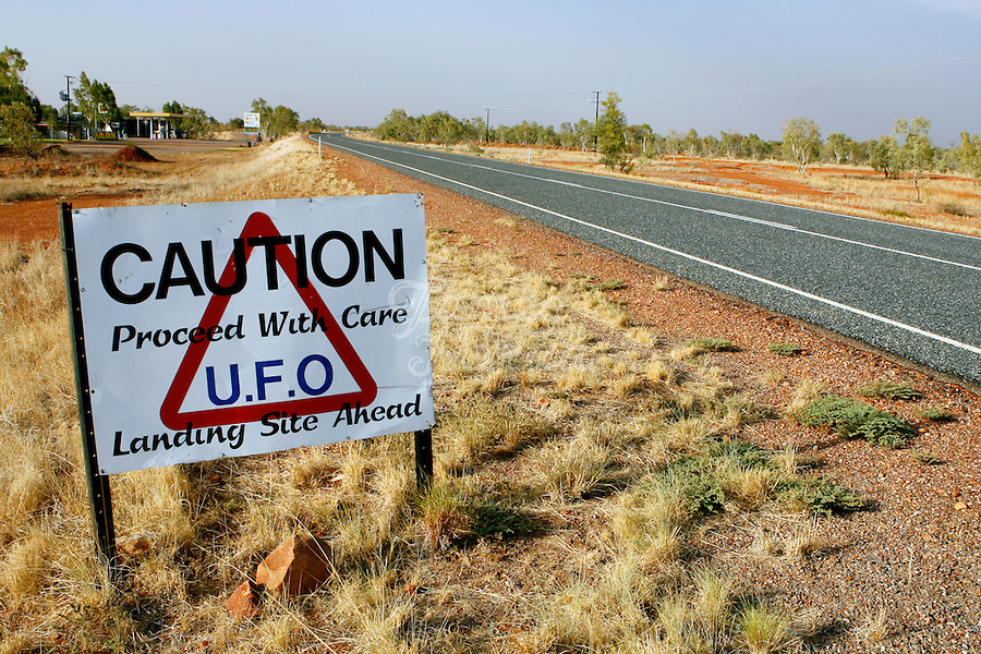 UFO sighting sign on the Stuart highway at Wycliffe Well, Northern territory, Australia. <br /> Wycliffe Well is renown for its regular UFO activities. recently ranked 5th for top reported UFO activity in the world. 400km north of Alice Springs, Wycliffe Well first made its way onto the paranormal map during World War II. The land here was relatively fertile and was used to grow vegetables, which meant extra supplies closer to the hub of troops in Darwin, which could be picked up on the long, lonely drive north <br />