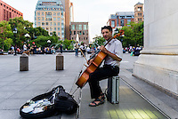 New York, NY 17 June 2014 Cellist Peter Lewy playing under the arch in Washington Square Park. ©Stacy Walsh Rosenstock/Alamy