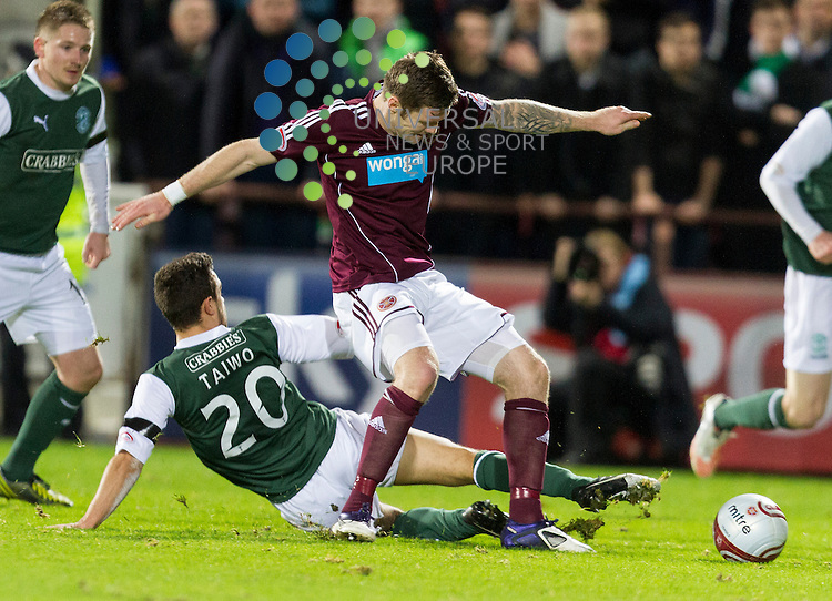 Hearts v Hibernian  SPL season 2012-2013 ..Tom Taiwo slides in on Arvydas Novikovas during the Clydesdale Bank Premier League match between Hearts and Hibernian at Tynecastle Stadium on Thursday 3 January 2013..Picture: Alan Rennie. Universal News & Sport