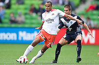 MELBOURNE, AUSTRALIA - SEPTEMBER 12, 2010: Reinaldo from the Roar defends the ball in Round 6 of the 2010 A-League between the Melbourne Victory and Brisbane Roar at AAMI Park on September 12, 2010 in Melbourne, Australia. (Photo by Sydney Low / Asterisk Images)