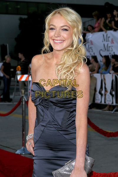 "LINDSAY LOHAN.At the ""Mr. & Mrs. Smith"" World Premiere held at Mann Village Theatre, Hollywood, CA, .USA, 7 June 2005..half length blue navy strapless dress blonde hair silver grey clutch bag.Ref: ADM.www.capitalpictures.com.sales@capitalpictures.com.©Jacqui Wong/AdMedia/Capital Pictures."
