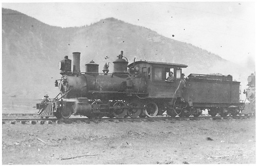 3/4 view of enigne with second engine behind.  Second track can be seen behind train.<br /> D&amp;RG  Silverton ?, CO