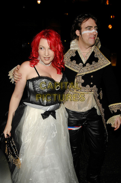 JANE GOLDMAN & JONATHAN ROSS.Arrive at a fancy dress party reception for Matt Lucas & Kevin McGee following their civil partnership ceremony (wedding) earlier the same day,.Banquetting House, Whitehall, London, England,.17th December 2006..half length funny costumes dressed-up black lace white dress dyed red hair married husband wife couple make-up stripe accross face.CAP/PL.©Phil Loftus/Capital Pictures