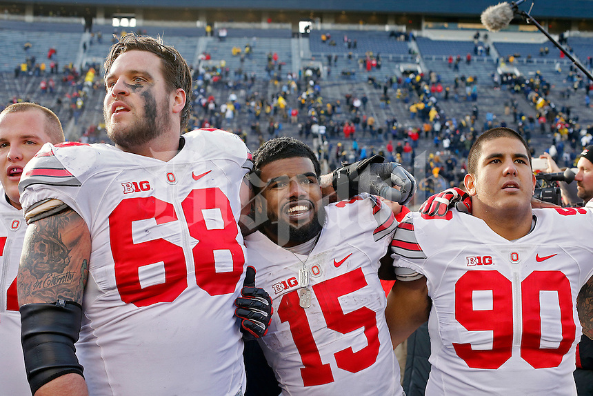 Ohio State Buckeyes offensive lineman Taylor Decker (68), running back Ezekiel Elliott (15) and defensive lineman Tommy Schutt (90) sing Carmen Ohio after the Buckeyes beat the Wolverines 42-13 at Michigan Stadium in Arbor, Michigan on November 28, 2015.  (Dispatch photo by Kyle Robertson)