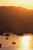 Sunset over Cat Ba Harbor, Halong Bay,  Vietnam