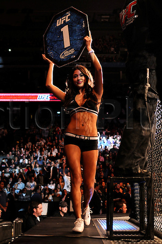 24.09.2011. Denver, Colorado. An Octagon girl announces the first round of a bout during UFC 135 at the Pepsi Center in Denver, Colorado.