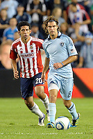Graham Zusi (8) sporting KC midfielder in action... Sporting Kansas City and Chivas Guadalajara played to a 2-2 tie in an international friendly at LIVESTRONG Sporting Park, Kansas City, Kansas.