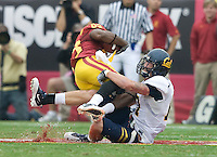 Chris Conte of California tackles Ronald Johnson of USC during the game at LA Memorial Coliseum in Los Angeles, California.  USC defeated California, 48-14.