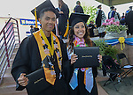 Christopher Ballesteros and Andrea Ruiz pose for a photo during the 2015 Western Nevada College Commencement held at the Pony Express Pavilion in Carson City, Nev., on Monday, May 18, 2015.<br /> Photo by Tim Dunn