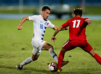 GEORGETOWN, GRAND CAYMAN, CAYMAN ISLANDS - NOVEMBER 19: Daniel Lovitz #5 of the United States moves with the ball as Jean Carlos Rodriguez #17 of Cuba defends during a game between Cuba and USMNT at Truman Bodden Sports Complex on November 19, 2019 in Georgetown, Grand Cayman.