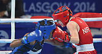 England's Nicola Adams defeats Northern Ireland's Michaela Walsh in the women's fly (48-51kg) final bout <br /> <br /> Photographer Chris Vaughan/CameraSport<br /> <br /> 20th Commonwealth Games - Day 10 - Saturday 2nd August 2014 - Boxing - The SSE Hydro - Glasgow - UK<br /> <br /> © CameraSport - 43 Linden Ave. Countesthorpe. Leicester. England. LE8 5PG - Tel: +44 (0) 116 277 4147 - admin@camerasport.com - www.camerasport.com