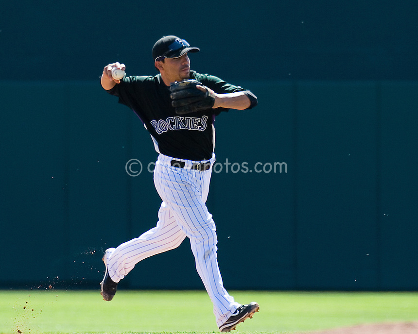Mar 23, 2008; Tucson, AZ, USA; Colorado Rockies shortstop Omar Quintanilla (6) throws to first during a game against the Los Angeles Dodgers at Hi Corbett Field. The Rockies beat the Dodgers 8-2.